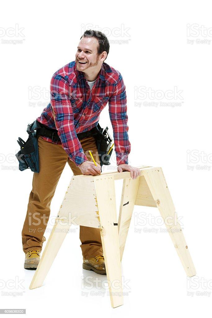 Cheerful carpenter working stock photo