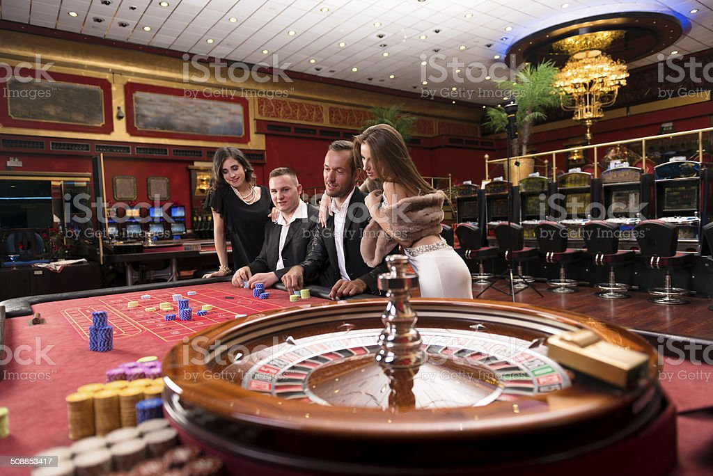 Cheerful Casino Players, Roulette Game, Europe stock photo