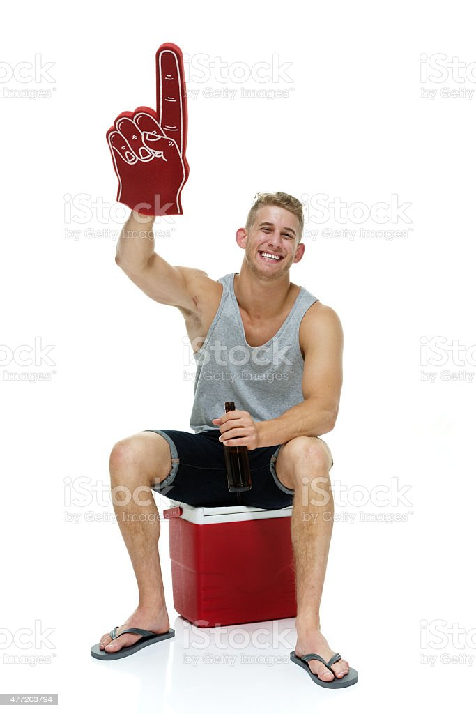 Cheerful casual man on cooler and pointing stock photo