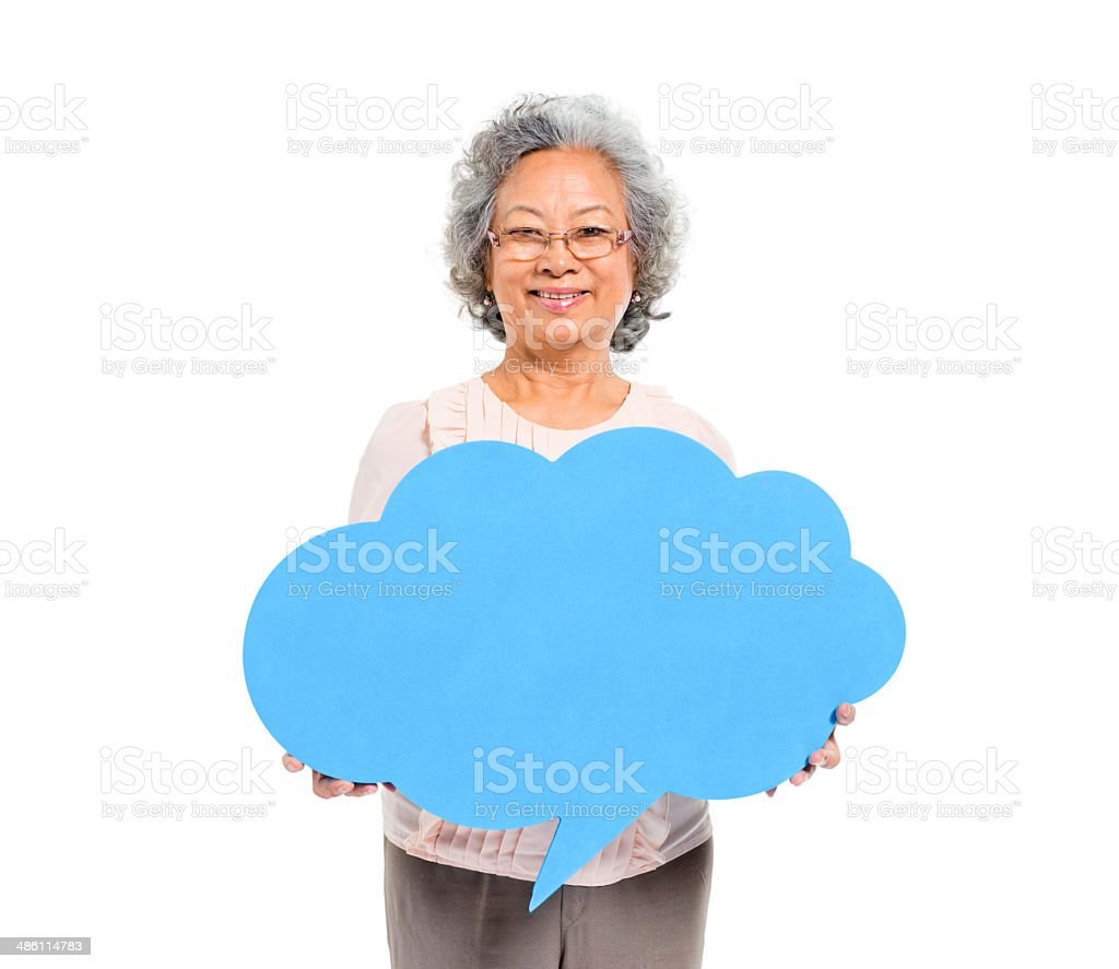 Cheerful Casual Mature Woman Holding Speech Bubble stock photo