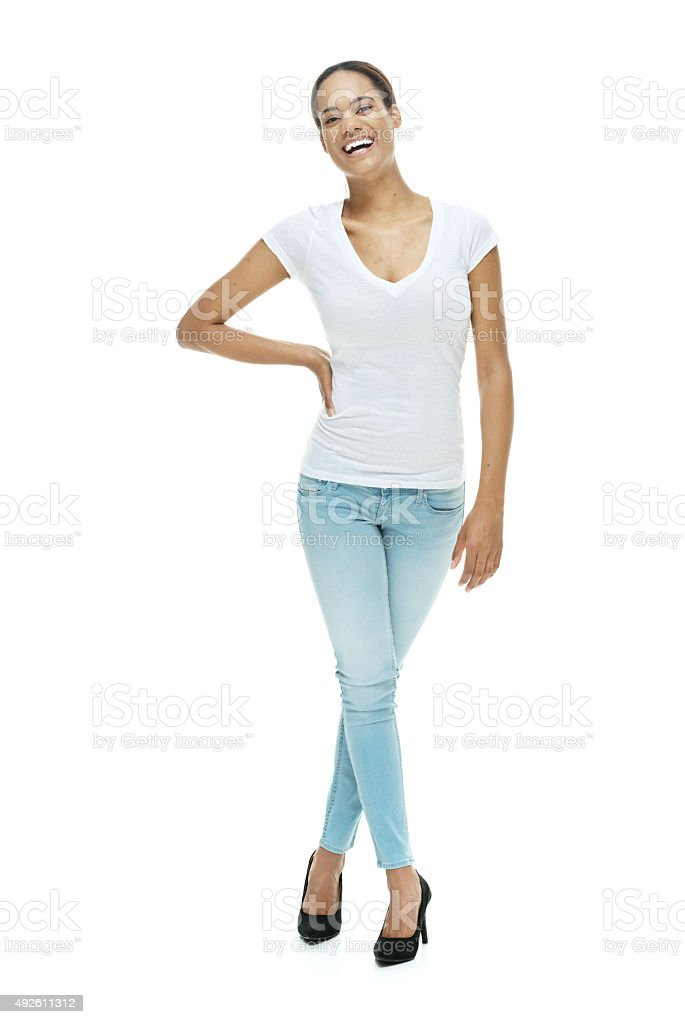 Cheerful casual woman looking at camera stock photo