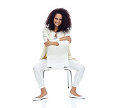 Cheerful casual woman sitting on chair