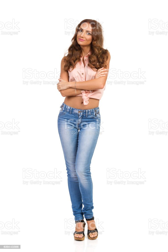 Cheerful Casual Woman Standing With Arms Crossed Isolated stock photo