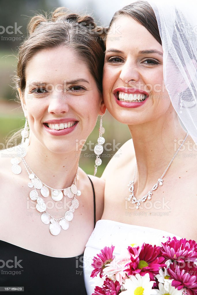 Cheerful Caucasian Bride and Maid of Honor royalty-free stock photo