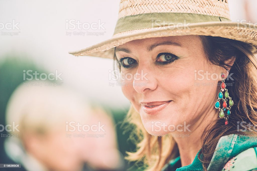 Cheerful caucasian mature woman with straw hat stock photo