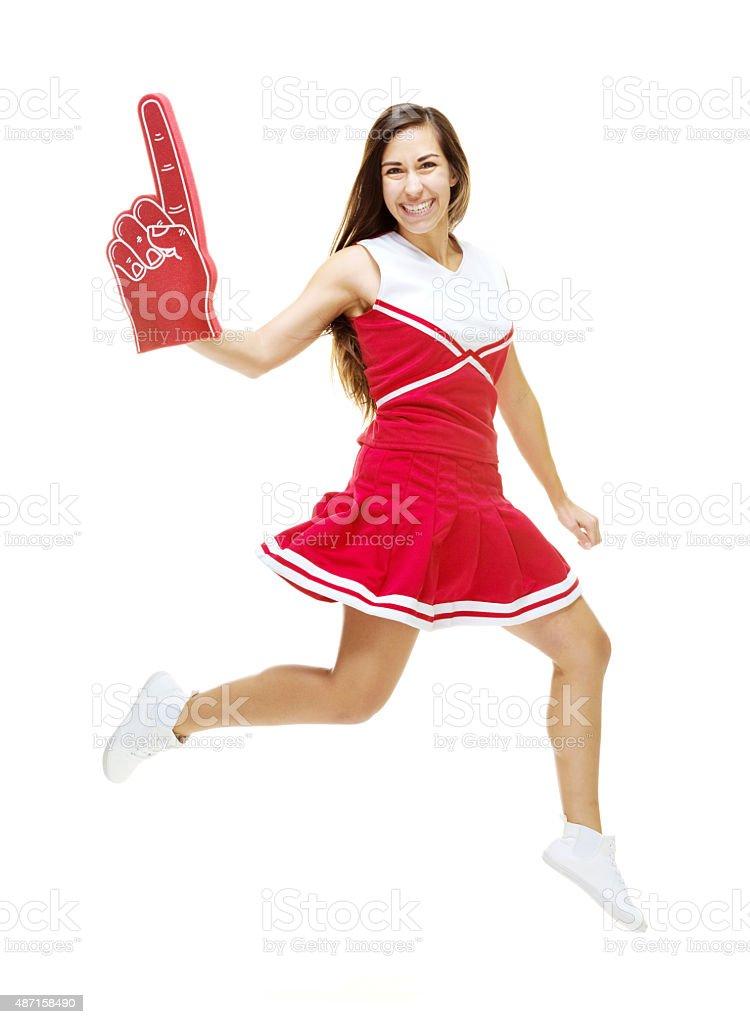 Cheerful cheerleader jumping stock photo