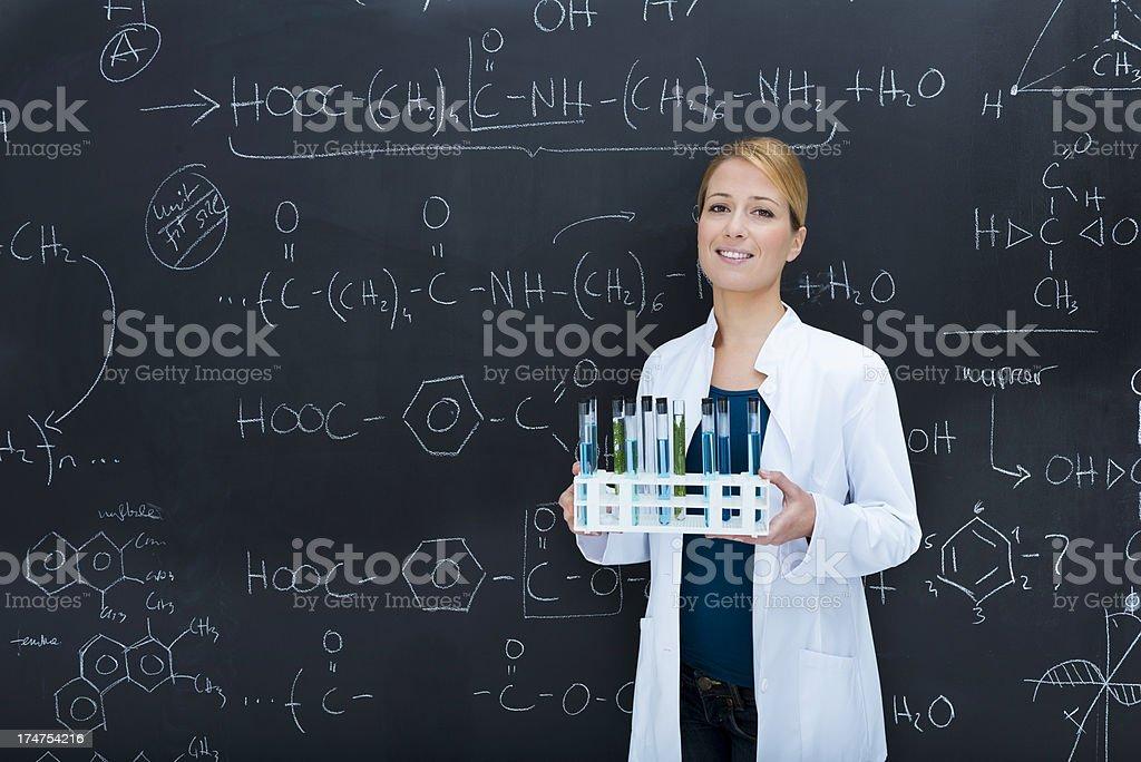 Cheerful chemist holding test tubes royalty-free stock photo