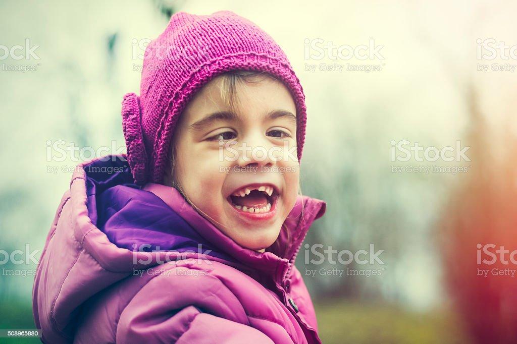Cheerful child portrait in nature stock photo