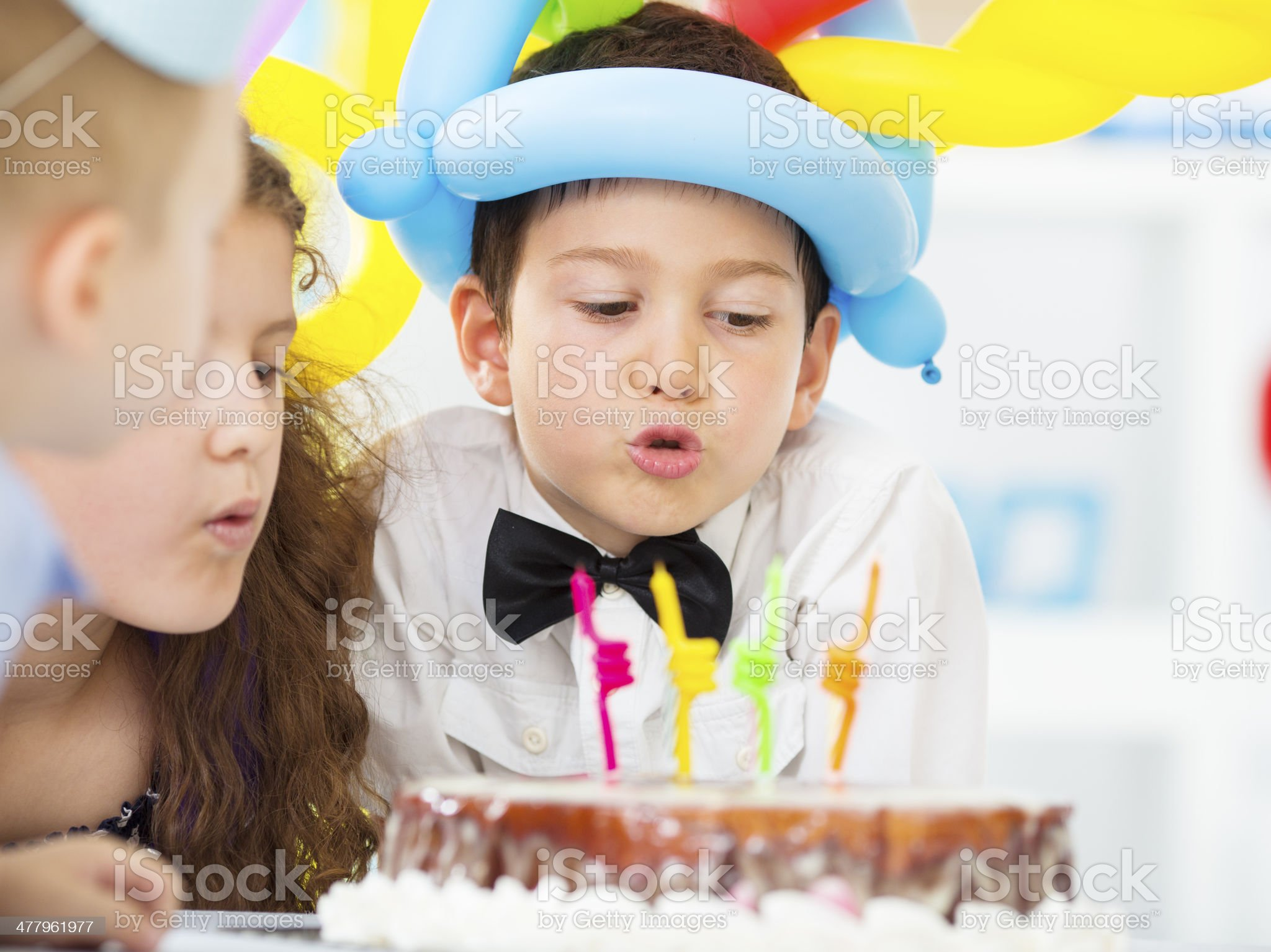 Cheerful Children Blowing Birthday Candles. royalty-free stock photo