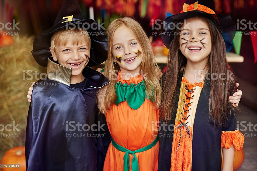 Cheerful children with Halloween face paint stock photo