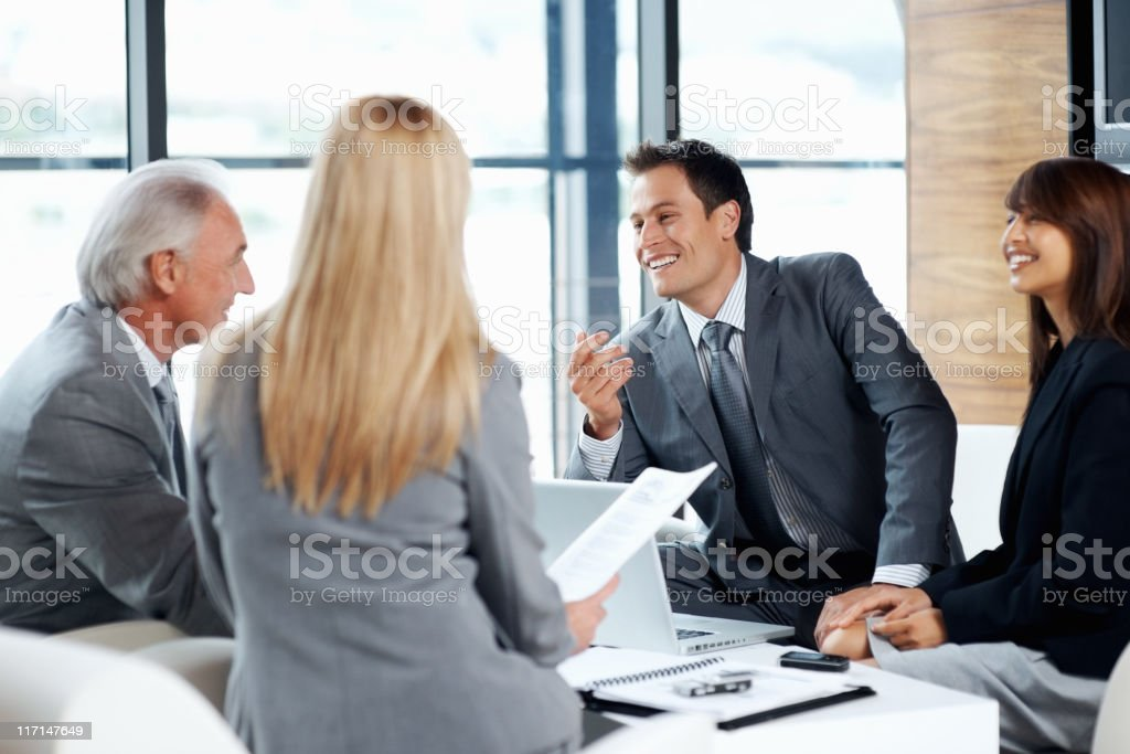 Cheerful colleagues discussing business project royalty-free stock photo