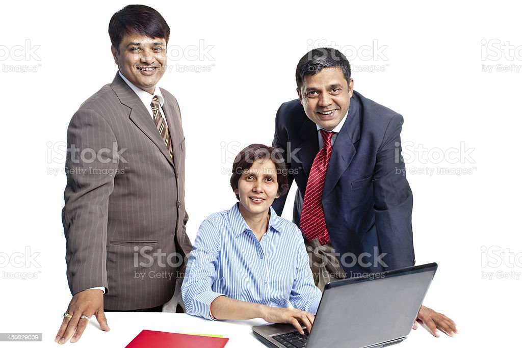 Cheerful Confident Indian Corporate Business Team with Laptop royalty-free stock photo