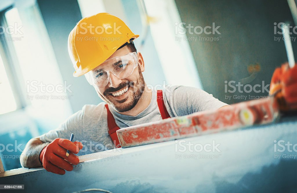 Cheerful construction worker. stock photo