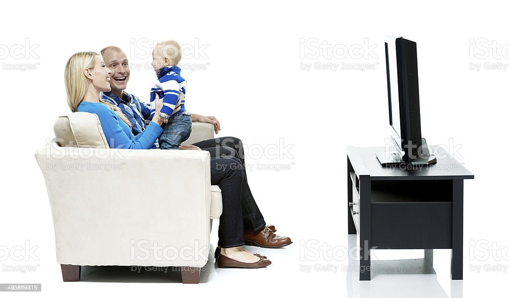 Cheerful couple bonding with their baby royalty-free stock photo