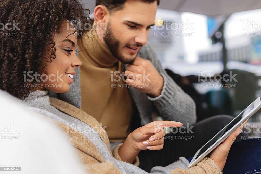 cheerful couple buying things online stock photo