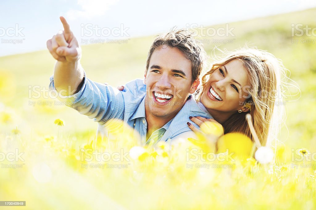 Cheerful couple enjoying in the nature royalty-free stock photo
