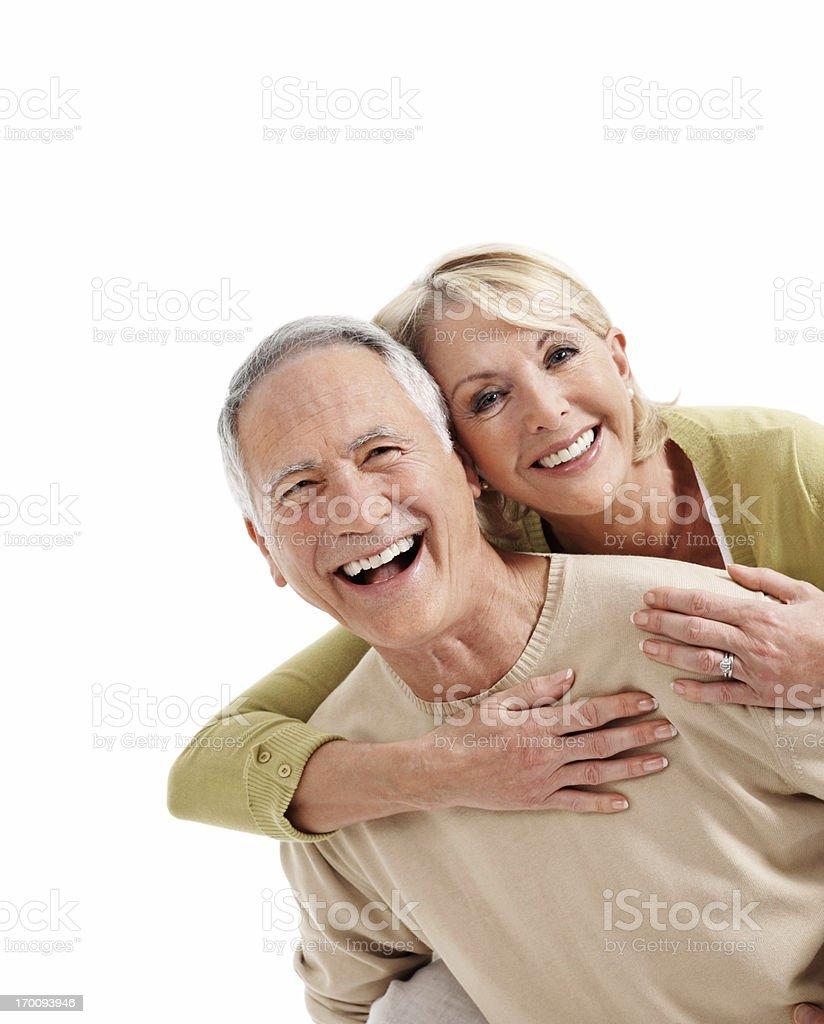 Cheerful couple enjoying piggyback ride royalty-free stock photo