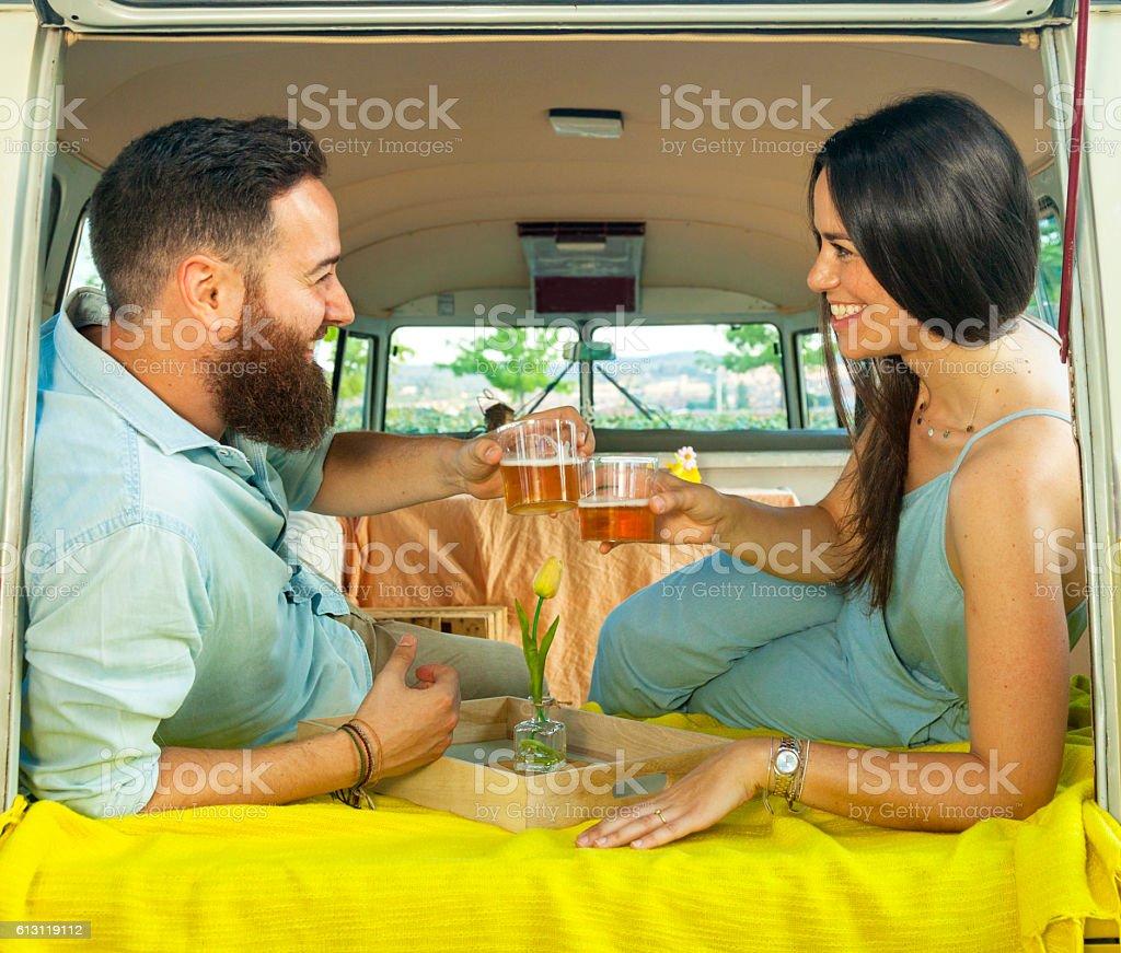 Cheerful couple enjoying  toasting while a travel break stock photo