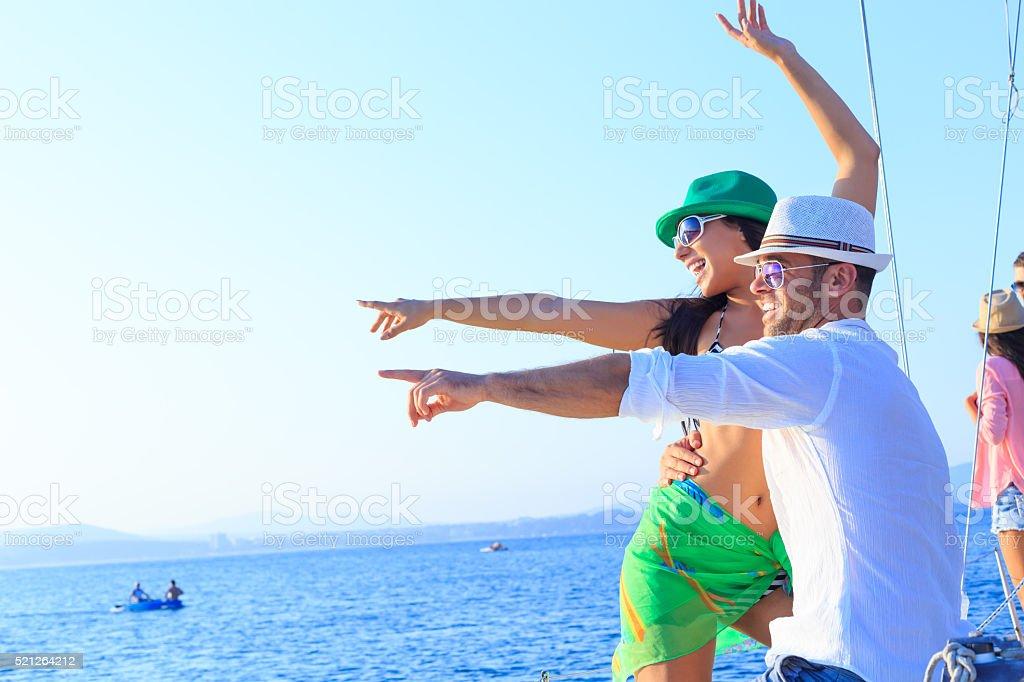 Cheerful couple enjoying yacht trip stock photo