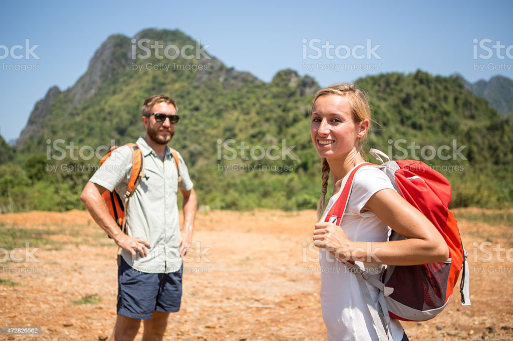 Cheerful couple hiking and enjoying nature stock photo