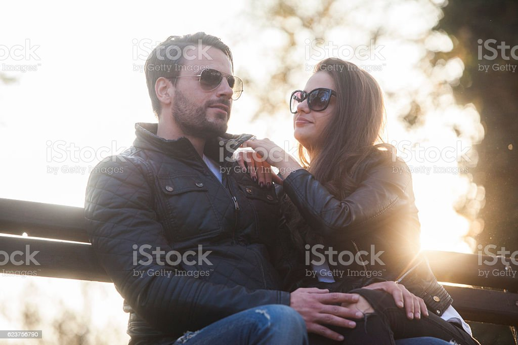 Cheerful couple in the park stock photo