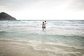 Cheerful couple in the sea