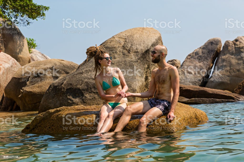 Cheerful couple in the sea stock photo
