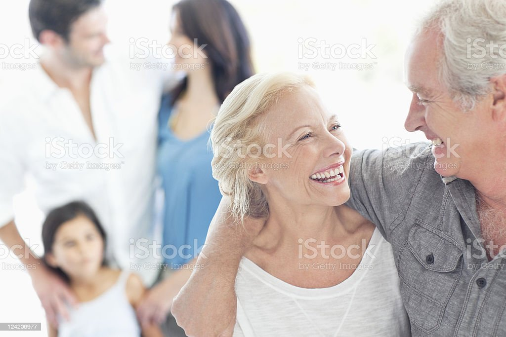 Cheerful couple looking at each other stock photo