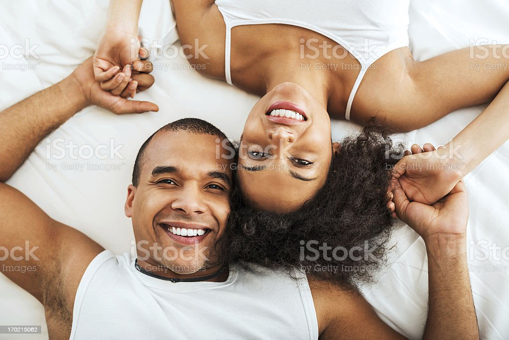 Cheerful couple lying in bed. royalty-free stock photo
