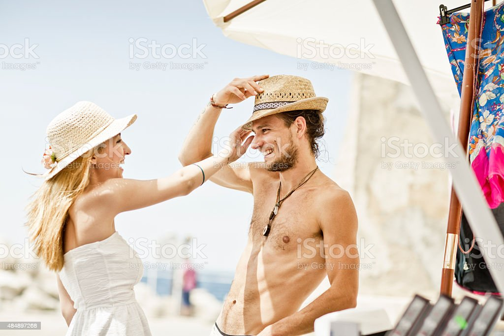 Cheerful couple  on a summer vacation shopping stock photo