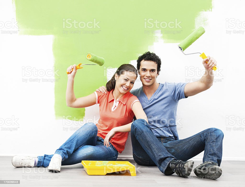 Cheerful couple painting the wall. royalty-free stock photo