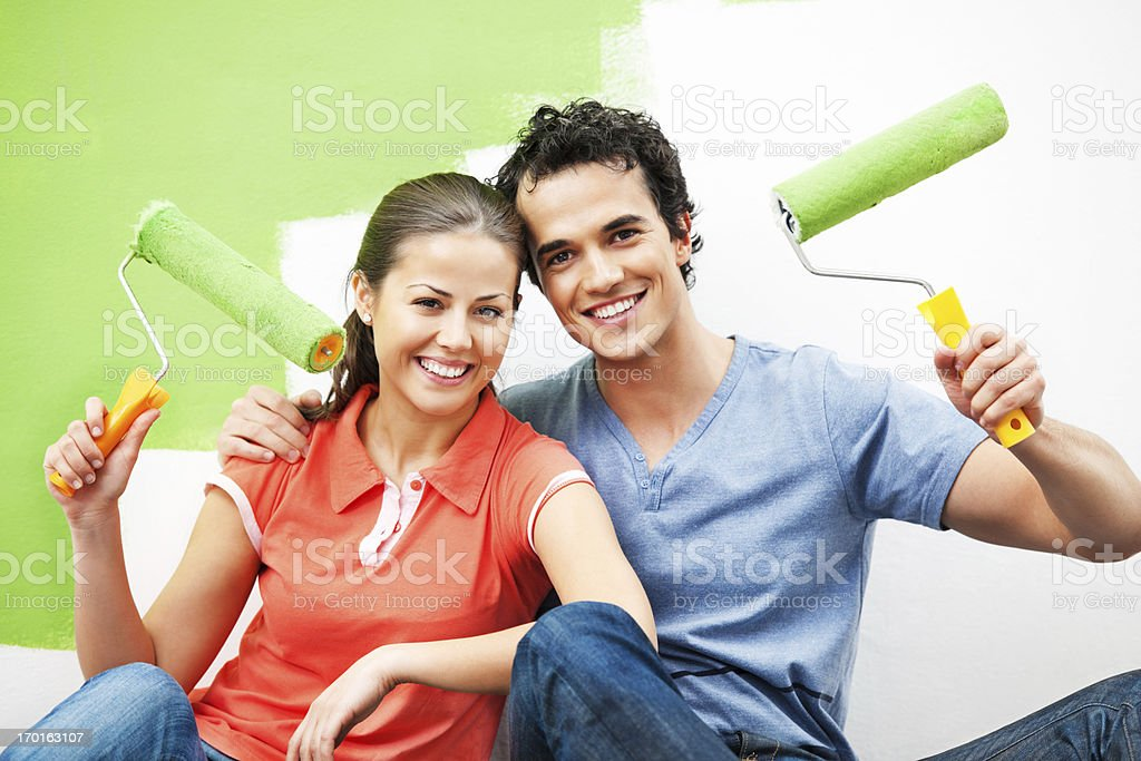 Cheerful couple painting the wall royalty-free stock photo