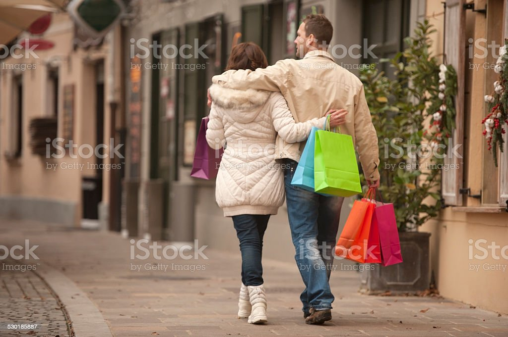 Cheerful Couple Shopping Together stock photo