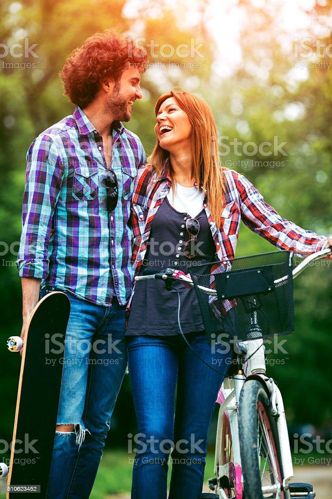 Cheerful Couple Walking Outdoors. stock photo