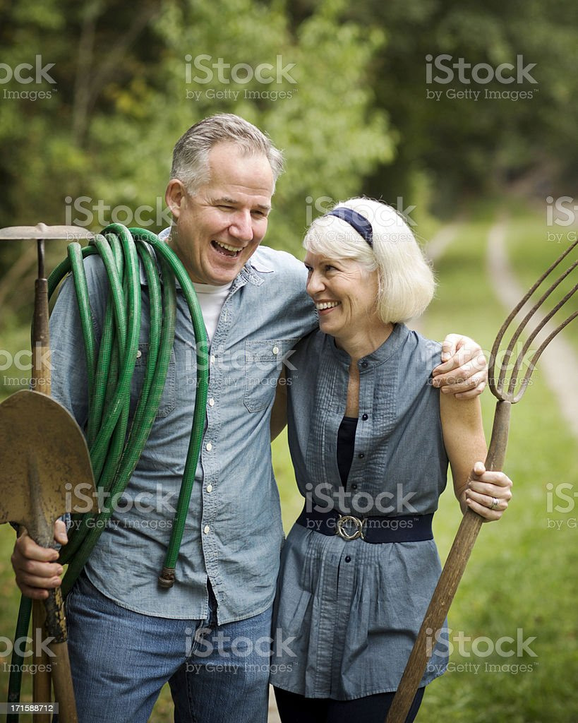 Cheerful Couple With Gardening Tools. royalty-free stock photo