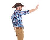 Cheerful cowboy waving hand