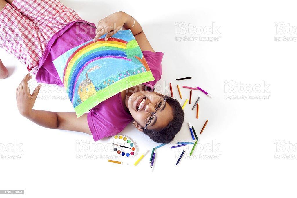 Cheerful Creative Indian Teenager Girl with Crayons and her Painting royalty-free stock photo