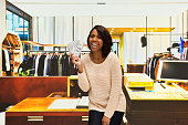 Cheerful customer excited by money in store