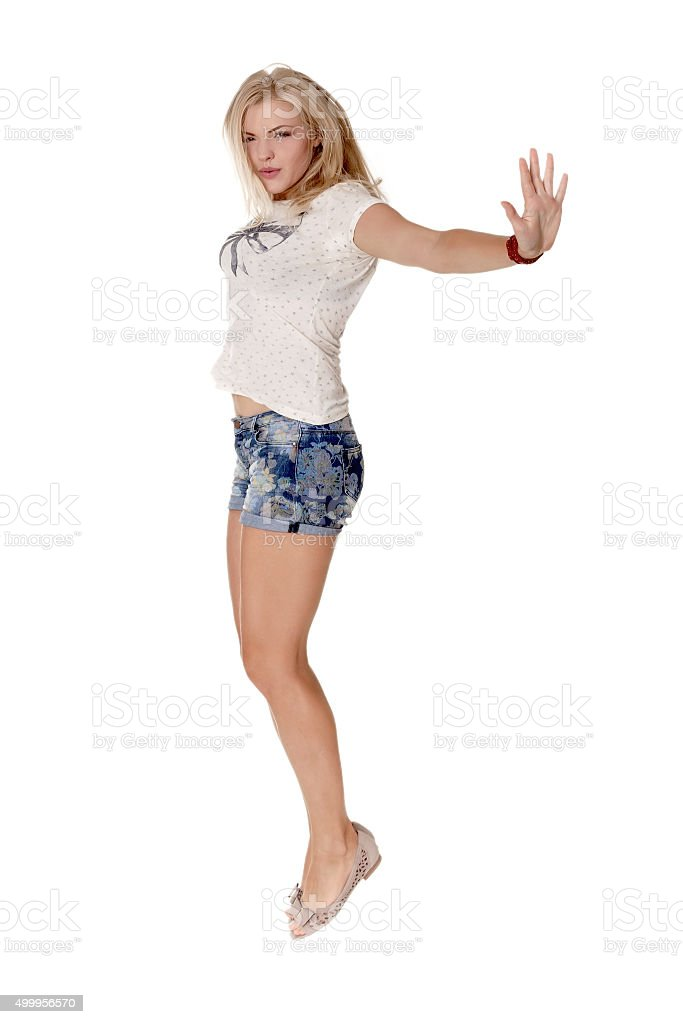 cheerful dancing girl jumping short on white background flying hair stock photo