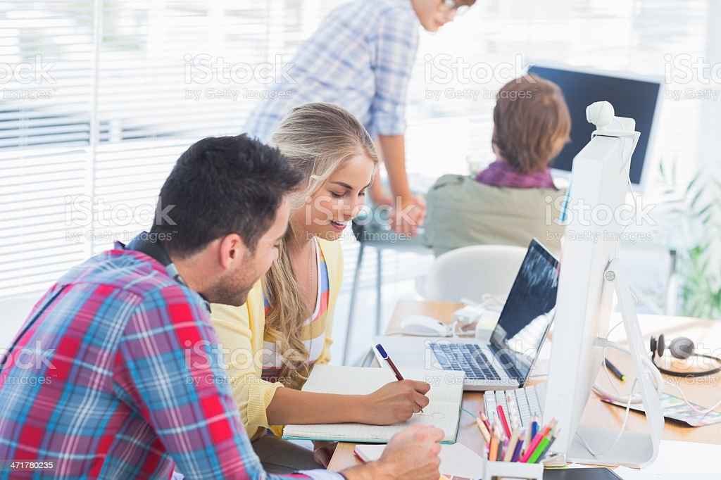 Cheerful designers working on a document royalty-free stock photo