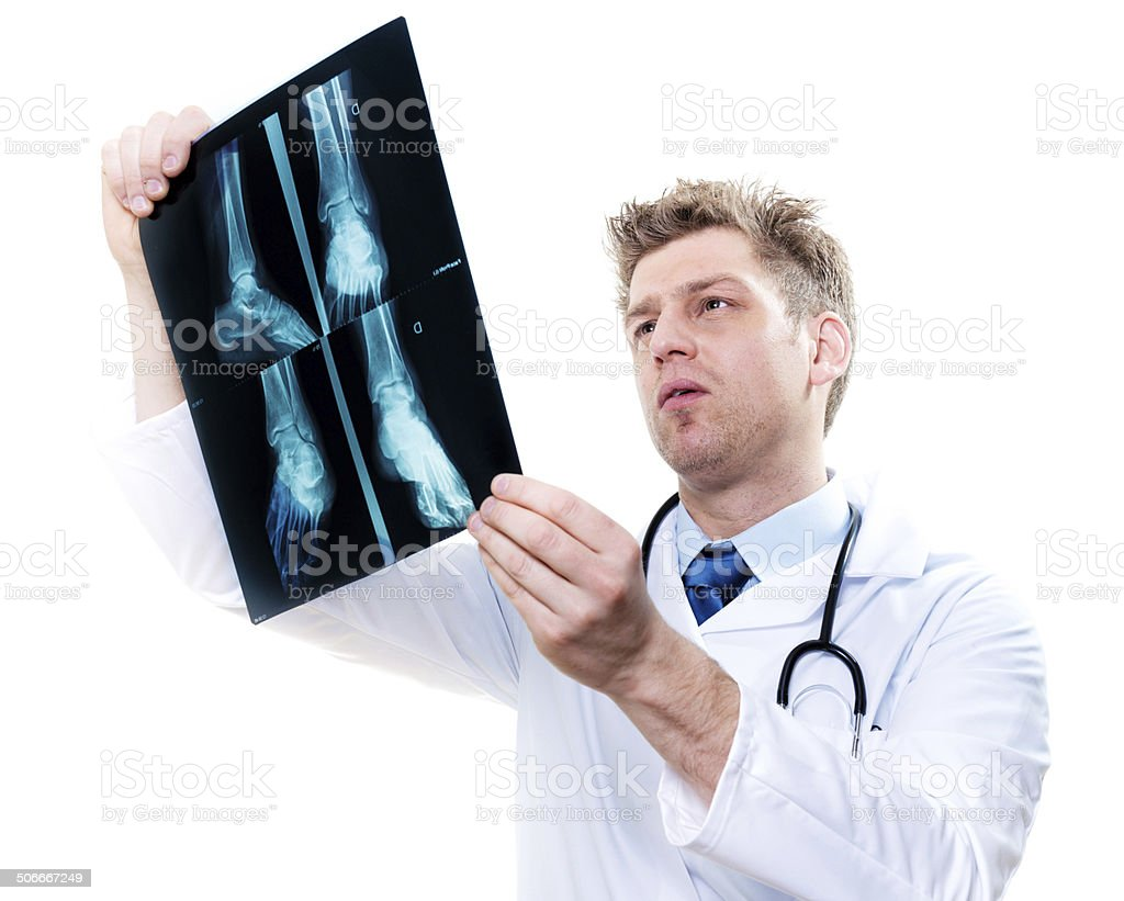 cheerful doctor examining feet x-ray stock photo