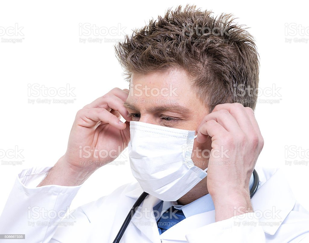 cheerful doctor wearing surgical mask and stethoscope royalty-free stock photo