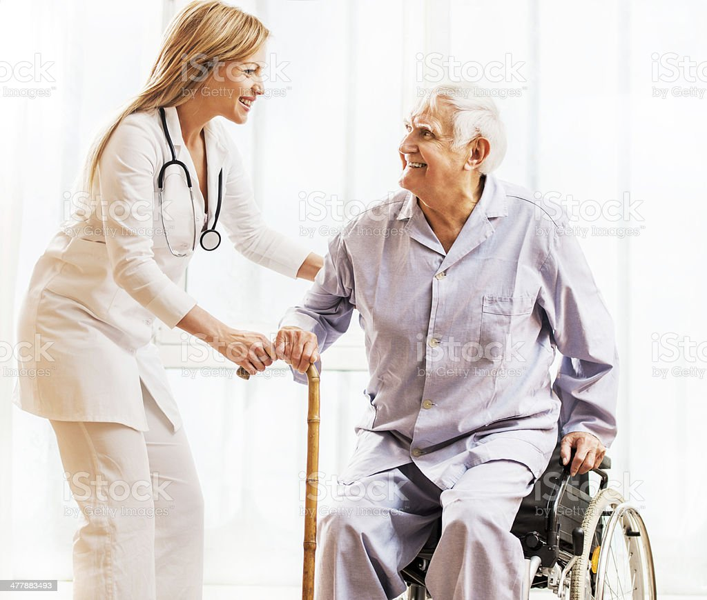 Cheerful doctor with a senior patient. royalty-free stock photo