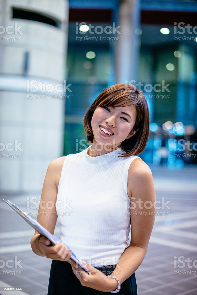 Cheerful employee with daily tasks stock photo