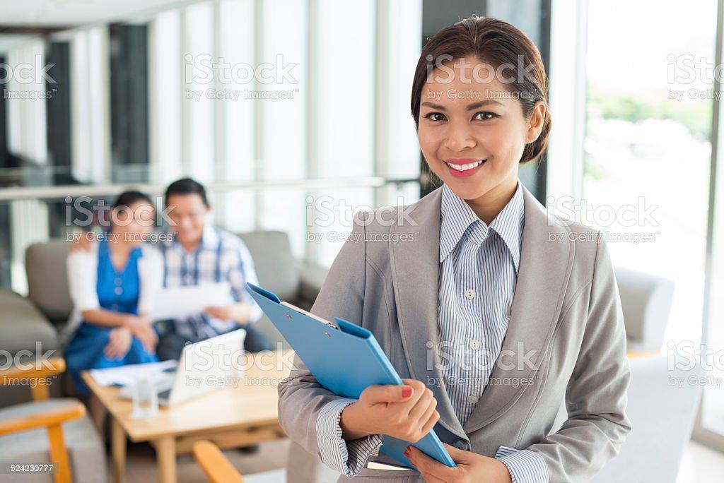 Cheerful estate agent stock photo