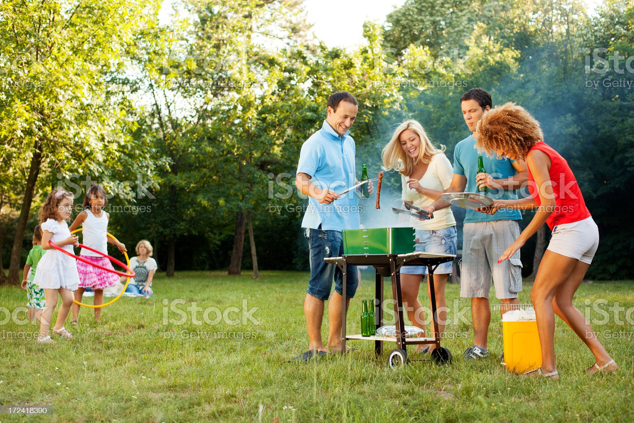 Cheerful Families barbecue outdoors. royalty-free stock photo
