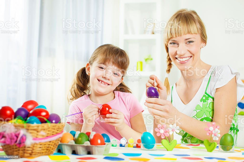 Cheerful Family Coloring Easter Egg. royalty-free stock photo