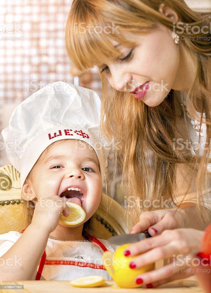 Cheerful family eating lemon royalty-free stock photo