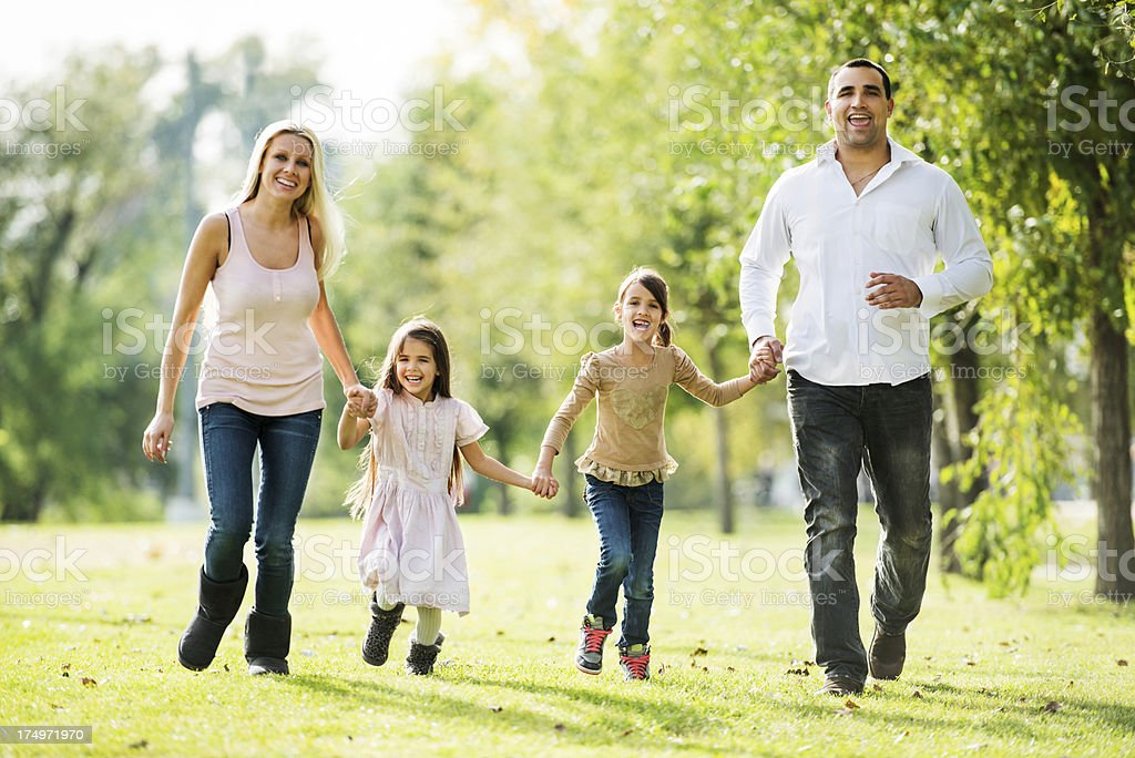Cheerful family enjoying while taking a walk in park. royalty-free stock photo