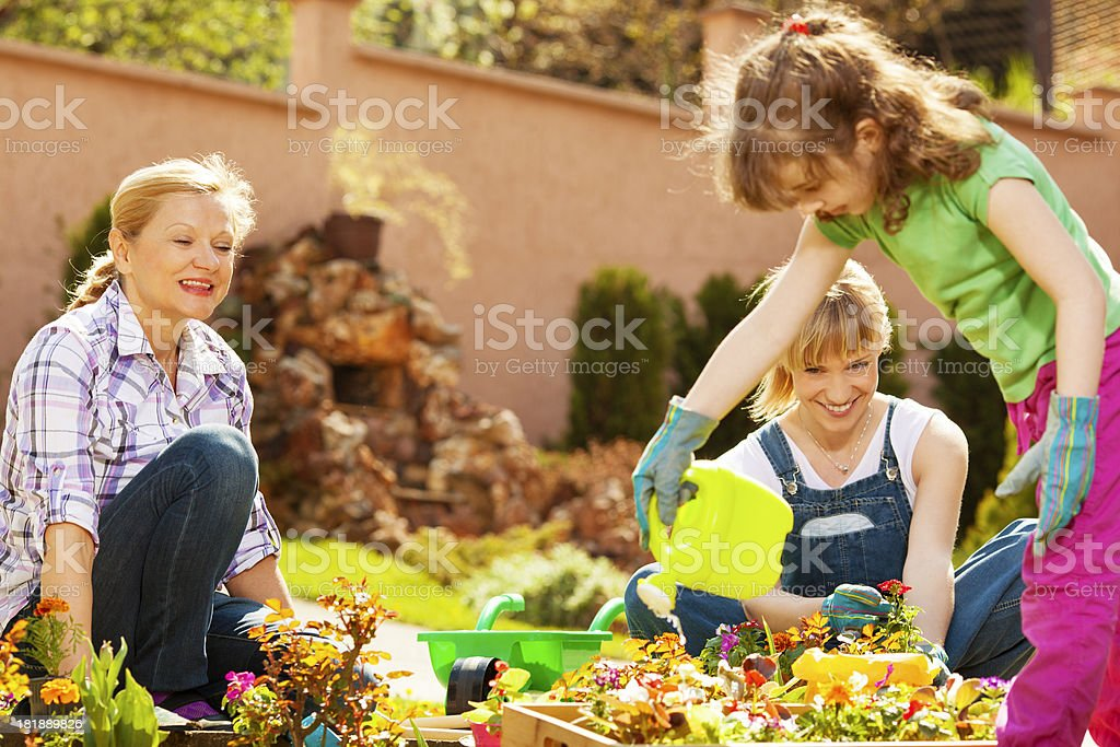Cheerful Family Gardening Together Outdoors. royalty-free stock photo
